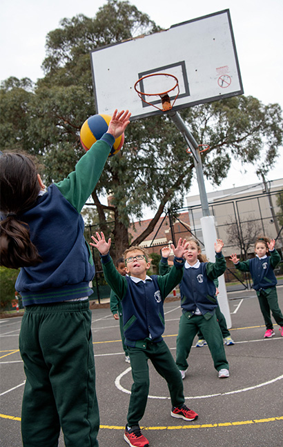 Students playing basketball at St Fidelis Primary School Coburg